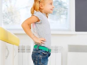 Portrait of little girl measuring herself.